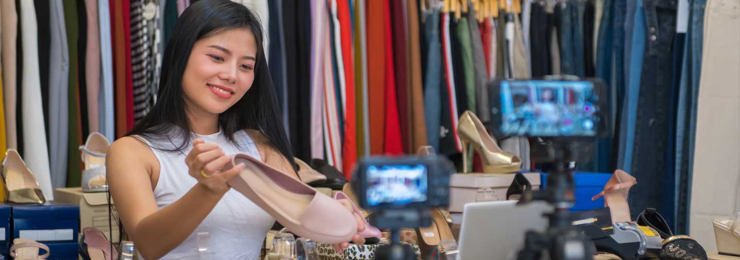 An entrepreneur photographs products for her online store.